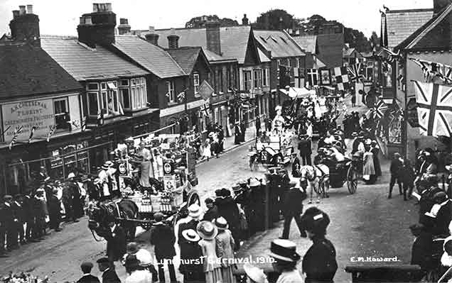Another image showing Lyndhurst carnival in 1910. (The shop opposite advertises the wares of A.H. Cheeseman, Florist, Greengrocer, Fruiterer, Landscape and Jobbing Gardener - a busy man)!