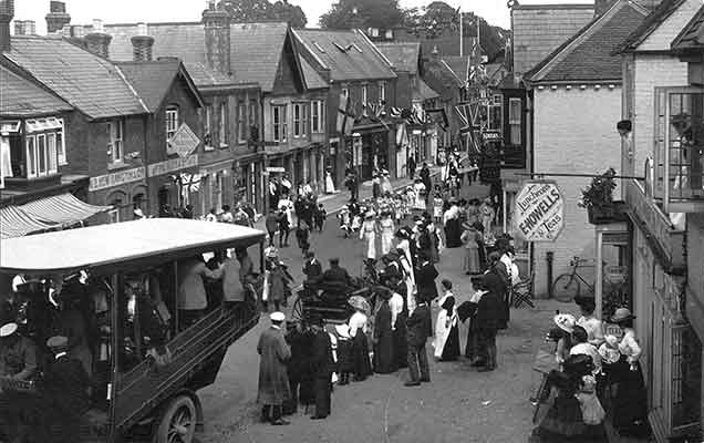 Lyndhurst - the 1912 carnival. (To the right of the picture, E. Howells advertises luncheons and teas, whilst across the road, the Volunteer Arms announces 'W.B. Mew Langton and Co - Fine Ales and Stout - the Volunteer ceased to trade in the early 1980s. Next door, a little farther down, is a printers)