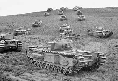 Churchill tanks of the 33rd Army Tank Brigade manoeuvre near Brockenhurst on 13 August 1942. (Image courtesy of the Imperial War Museum)